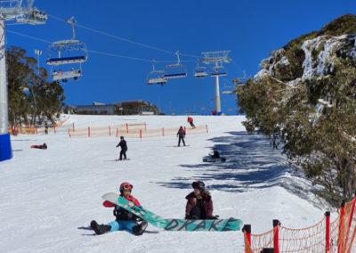 Snow boarding on sunny day Mt Buller