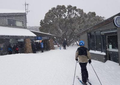 Skiing through village at Mt Buller